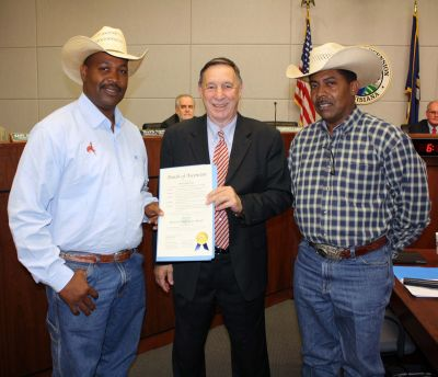 Ascension Parish President Tommy Martinez (center) presented a parish proclamation to Isaac King (left) and Archer Lee at the April 18 Ascension Parish Council meeting. President Martinez proclaimed May as National Black Rodeo Month in Ascension Parish.